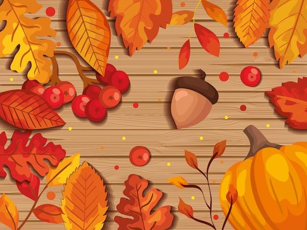 Hojas de otoño en el fondo de madera con frutos secos