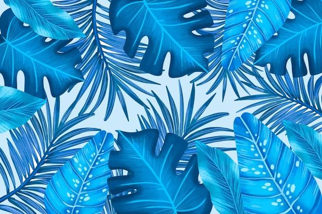 Hojas tropicales azules monocromáticas