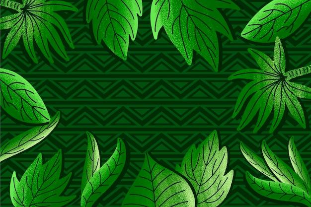 Hojas tropicales verdes sobre fondo geométrico