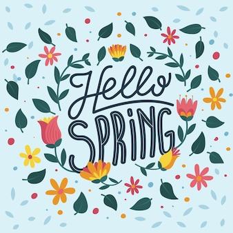 Hola caligrafía primaveral con círculo de hojas