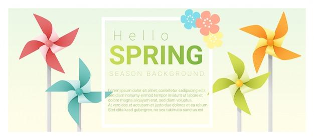 Hola fondo de primavera con molinetes de colores.