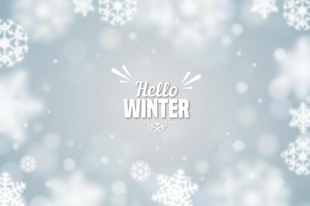 Hola invierno con fondo borroso de copos de nieve