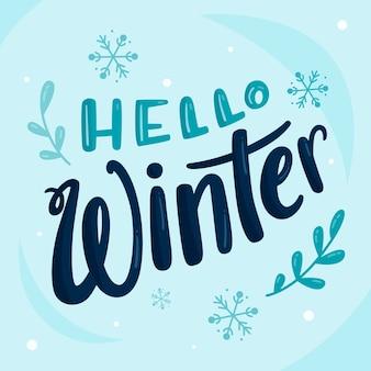 Hola letras de invierno con copos de nieve