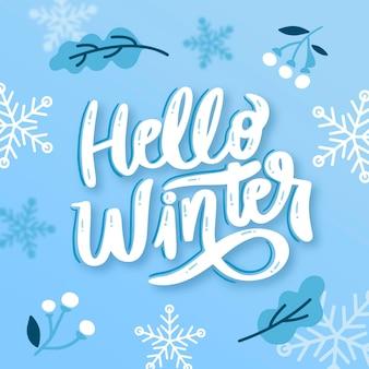 Hola letras de invierno con elementos dibujados.