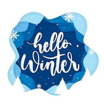 Hola letras de invierno sobre fondo azul con copos de nieve