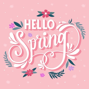 Hola letras de primavera sobre fondo rosa