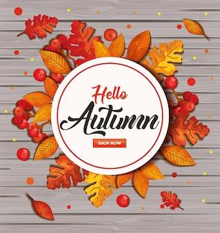 Hola otoño en madera con marco y hojas.