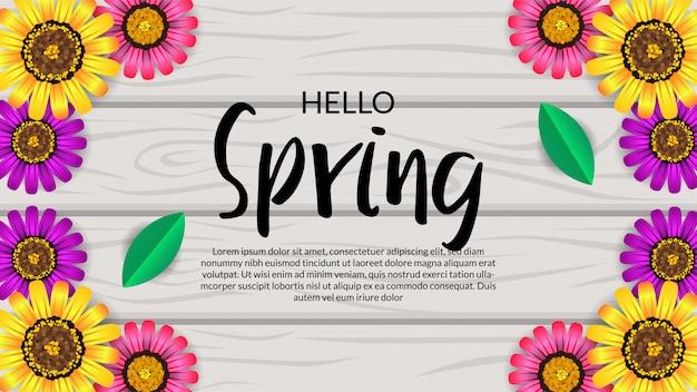 Hola primavera flor vista superior flor en la madera