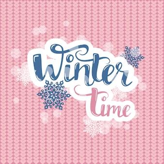 Hola texto de invierno en tejer rosa. vector pincel letras con copos de nieve.
