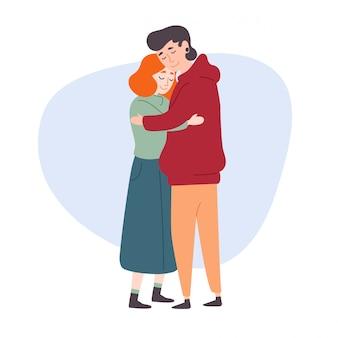 El hombre abraza a una mujer.