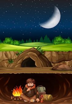 Un hombre acampando en la cueva.