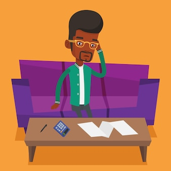 Hombre africano infeliz que contabiliza las cuentas caseras.