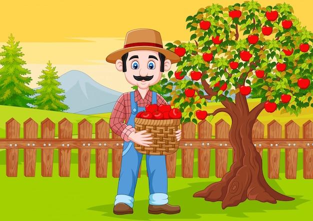 Hombre agricultor de dibujos animados con cesta de manzana en la granja