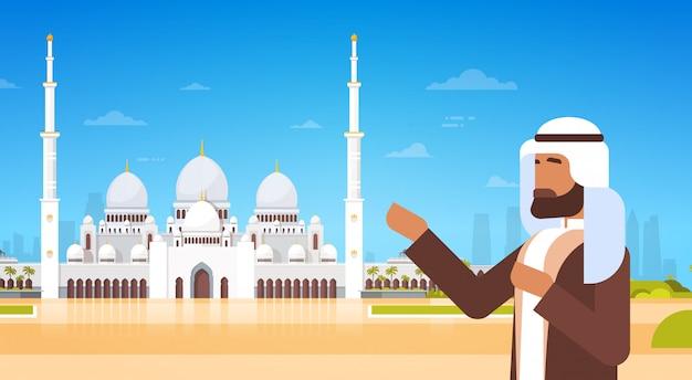 Hombre árabe mostrar mezquita edificio musulmán religión ramadán kareem mes sagrado