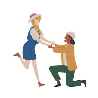 Hombre arrodillado proponiendo mujer casarse con él.