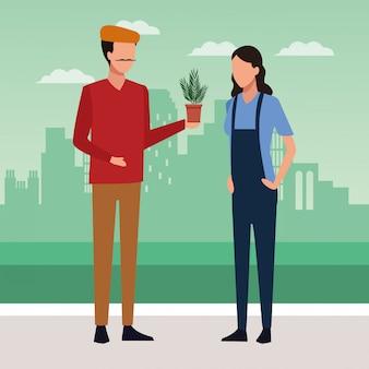 Hombre artista sosteniendo una maceta y mujer de pie