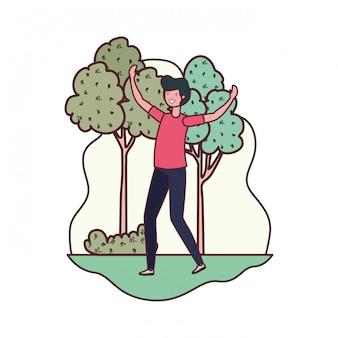 Hombre bailando en paisaje con arboles y plantas.