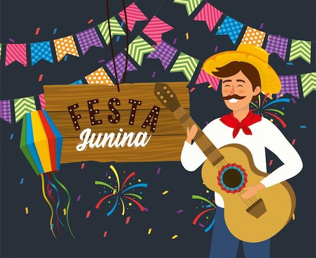 Hombre con banner de guitarra y fiesta con fuegos artificiales.