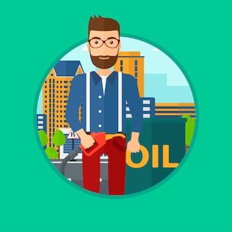 Hombre con barril de aceite y boquilla de bomba de gas.