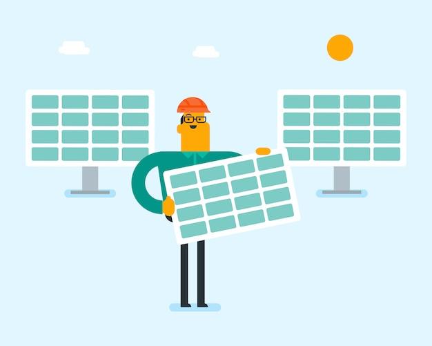 Hombre blanco caucásico joven que sostiene el panel solar.