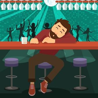 Hombre borracho alcohólico dormido en el bar de la discoteca