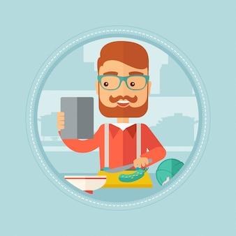 Hombre buscando receta de ensalada en tableta digital