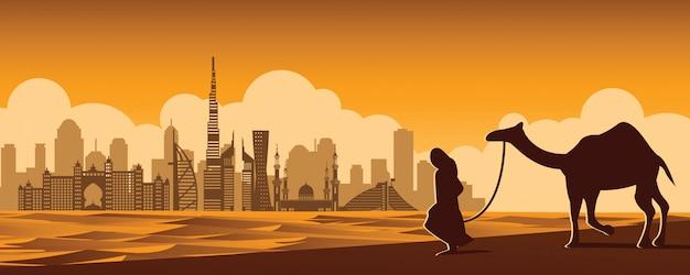 El hombre y el camello caminan en el desierto