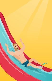 Hombre caucásico joven que monta en un tobogán de agua