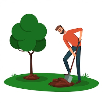 Hombre cavando un agujero para un árbol