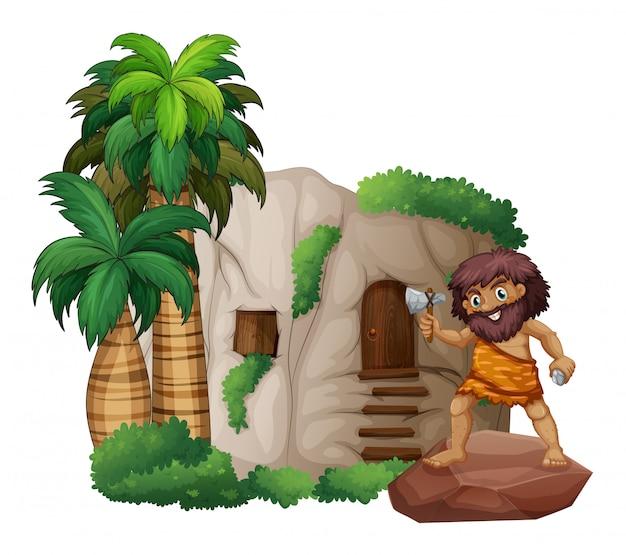 Hombre de las cavernas y casa