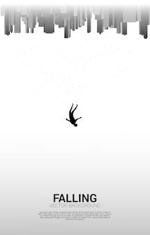 Hombre cayendo del cielo a la gran ciudad. concepto de sentirse solo y fallar en la gran ciudad