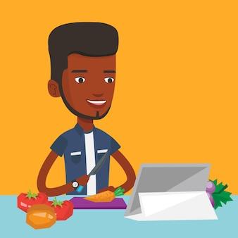Hombre cocina ensalada de vegetales saludables.