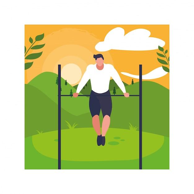 Hombre colgado en barra horizontal, deporte al aire libre o gimnasio