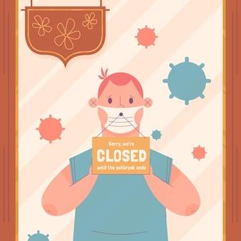 Hombre colgando un letrero cerrado por coronavirus