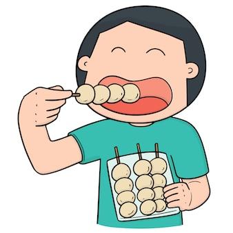 Hombre comiendo albóndigas