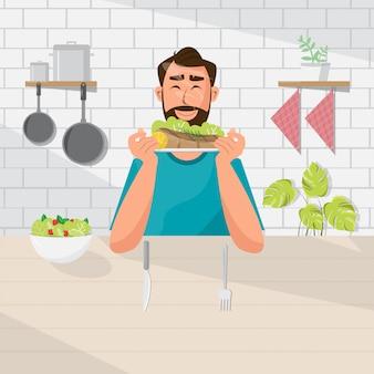 El hombre está comiendo ensalada y carne
