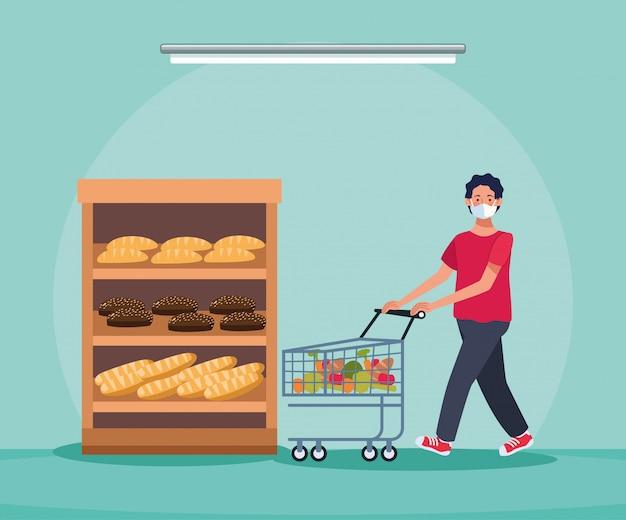 Hombre de compras en el supermercado con mascarilla