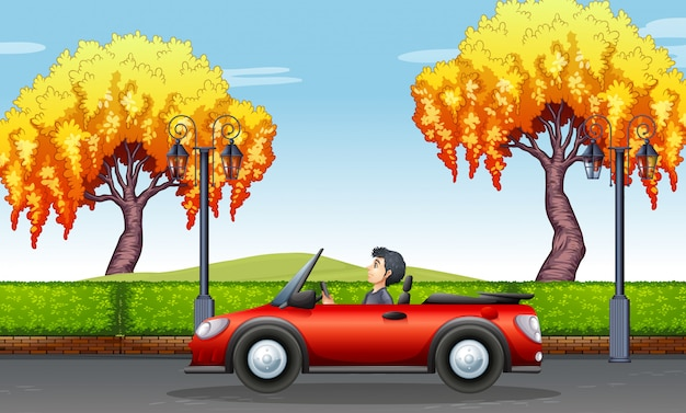 Hombre conduciendo un coche descapotable en el parque