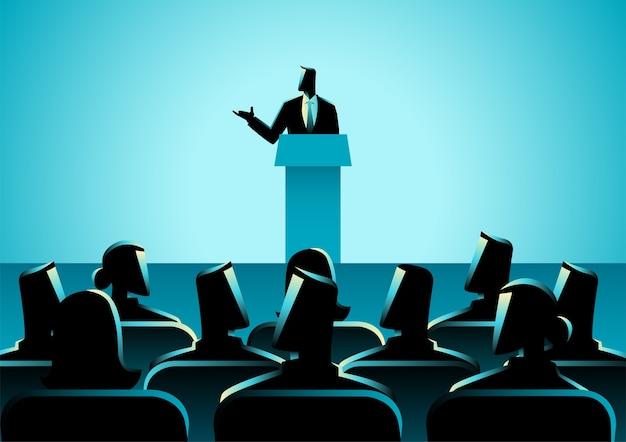 Hombre dando un discurso en el escenario