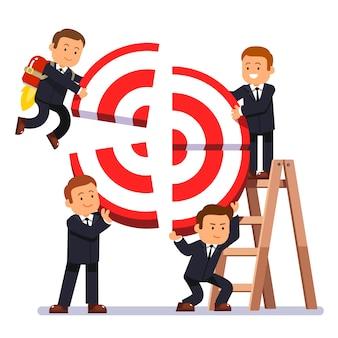 Hombre de negocios, equipo, edificio, objetivo