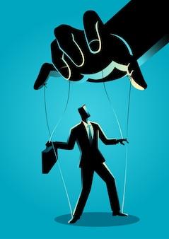 Hombre de negocios siendo controlado por el maestro de marionetas