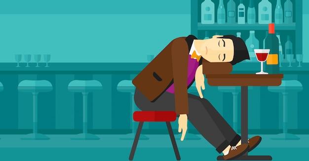 Hombre durmiendo en el bar