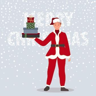 Hombre feliz con caja de regalos de navidad hombre vestido con ropa roja de santa claus sobre fondo de nieve