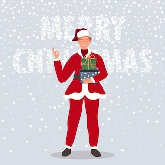 Hombre feliz con caja de regalos de navidad hombre vestido con ropa de santa claus sobre fondo de nieve