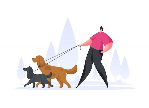 Hombre feliz caminando con perros en el parque