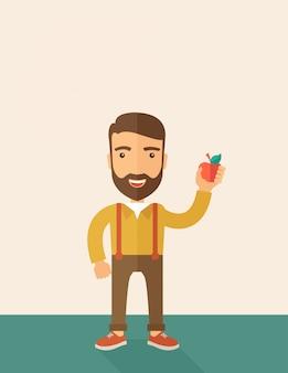Hombre feliz que sostiene una manzana roja.