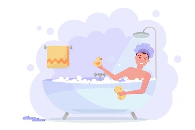 Hombre en gorro de ducha tomando baño con la ducha.