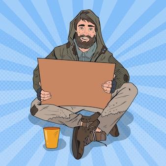 Hombre sin hogar del arte pop. mendigo masculino con letrero de cartón para pedir ayuda.