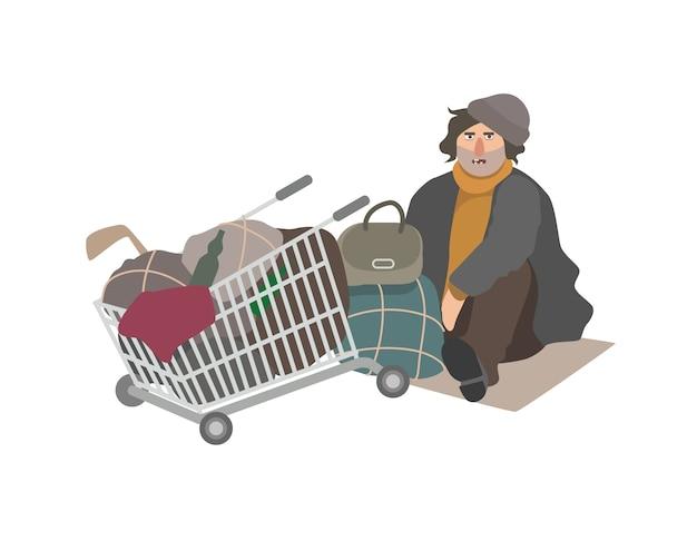 Hombre sin hogar enojado vestido con ropa gastada sentado en una hoja de cartón
