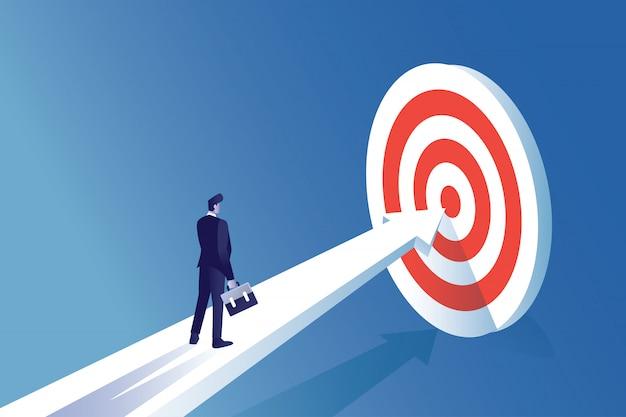 Hombre de ilustración del concepto de empresario de pie delante de la placa de destino para centrarse en lograr la meta